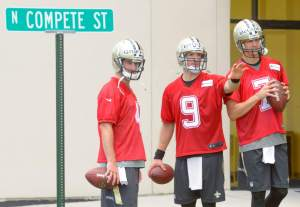 Advocate staff photo by MATTHEW HINTON--New Orleans Saints quarterback Drew Brees (9), center, sets up a throwing game with New Orleans Saints quarterback Ryan Griffin (4), left, and quarterback Luke McCown (7) practices at the Saints Training Facility in Metairie, La. Thursday, May 28, 2015.